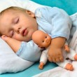 Boy sleeping in a bed — Stock Photo
