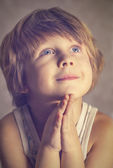 Boy at prayer — Stock Photo