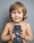 Boy with an old camera — Stock Photo