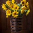 Still life. Beautiful Sunflowers  against a wooden wall — Stock Photo