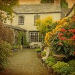 Garden at the front of  old house, Lake District, Cumbria, UK. — Stock Photo