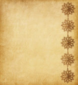 Paper background decorated with golden snowflakes — Stock Photo