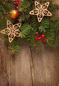 Christmas decoration on wooden plank. — Stock Photo