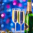 Two glasses of champagne with a Christmas decor in the background — Stock Photo