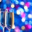Two glasses of Sparkling wine with lights in the background — Lizenzfreies Foto