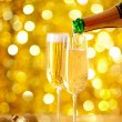 Pouring Champagne in a flute with a festive background — Foto Stock