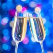 Two glasses of champagne with lights in the background — Stock Photo