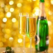 Two glasses of champagne with a Christmas decor in the background. — Stock Photo