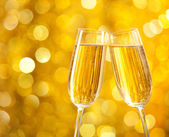 Two glasses of champagne with lights — Foto Stock