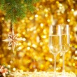 Two glasses of wine with a Christmas decor in the background. — Stock Photo