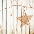 Christmas decoration hanging over  old wooden board — Stock Photo