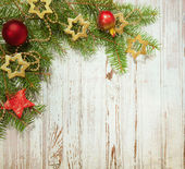 Christmas decoration on old wooden board — Stockfoto
