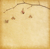 Christmas decoration hanging over paper background — Stock Photo