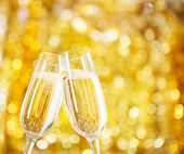 Two glasses of champagne with lights in the background. — Stock Photo