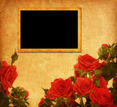 Photo frames on a paper with roses — Stock Photo