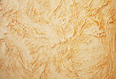 Decorative golden stucco texture — Stockfoto