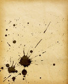 Old grunge paper background with blots — Stock Photo