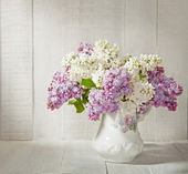 Lilac Bouquet  in old ceramic jug — Stock Photo