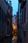 Narrow canal in Venice at  twilight — Stock Photo
