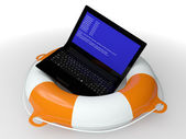 Lifebuoy ring and faulty computer  — Stock Photo