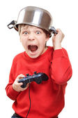 Shouting boy with gamepad in hands — Stock Photo