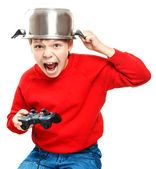 Shouting boy with gamepad in hands — Stok fotoğraf