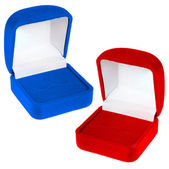 Open red and blue velvet boxes — Stock Photo