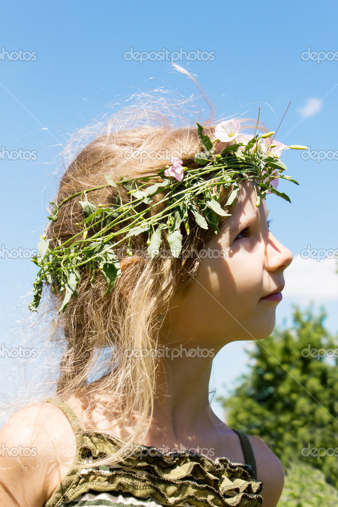 Girl in the grass wreath convolvulus arvensis 4633  Stock Photo #12620089