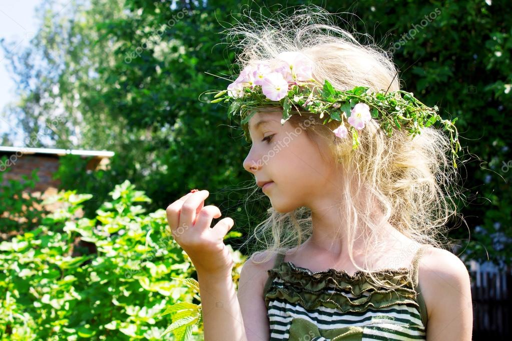 Girl in the grass wreath convolvulus arvensis 4633  Stock Photo #12620095