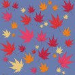 Vector seamless background: a lot of maple autumn leaves on the ground. — Stock Vector