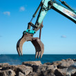 Stock Photo: Rock grab for excavators