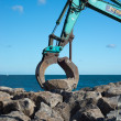 Stock Photo: Excavator's rock grab