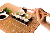 Eating sushi rolls — Stock Photo