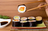 Sushi rolls on wooden background — Stok fotoğraf
