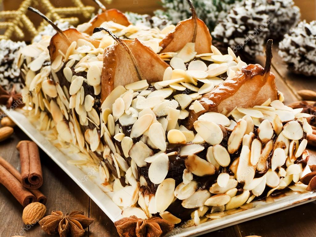 Christmas cake with pears, chocolate cream and almonds. Shallow dof. — Stockfoto #13885941