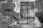 Closed window with old wooden shutters. — Stock Photo