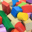 Stack of colorful wooden building blocks — Stock Photo
