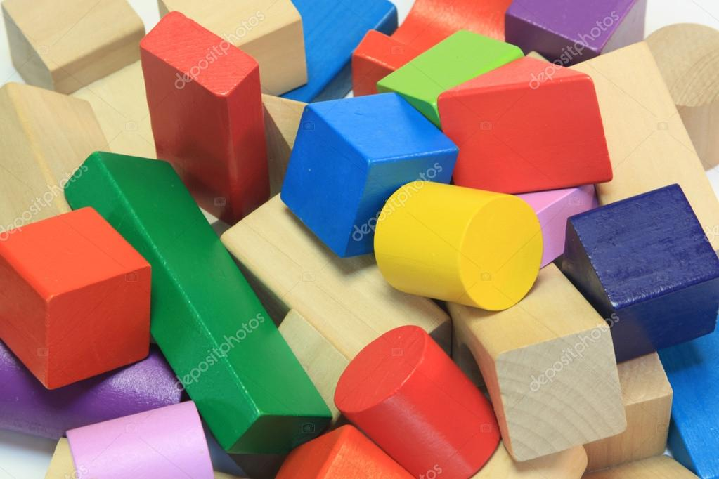 Stack of colorful wooden building blocks — Stock Photo #16336983