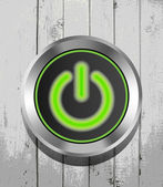 Green power button icon on the wooden background — Stock Vector