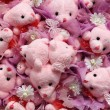 Cute background from bears with flowers — Stock Photo