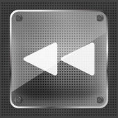 Glass rewind icon on a metallic background — Stockvector