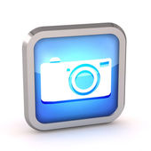 Blue digital camera icon button on a white background — Stock Photo