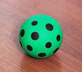 Green ball with black spots — Stock Photo