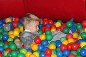 Little boy playing with balls — Stock Photo