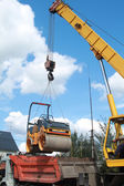 Loading compactor on the transportation machine using a crane — Stock Photo