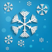 Abstract paper snowflakes on blue background — Stock Vector
