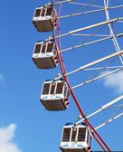 Large Ferris wheel's cabins on the blue sky — Stock Photo