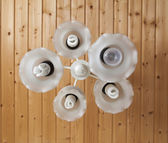 White chandelier with eco bulb — Stock Photo