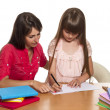 Mother and daughter doing homework — Stock Photo