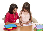Mother and daughter doing homework — Stockfoto